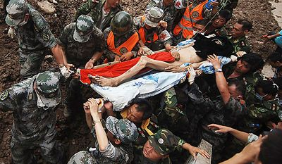In this photo provided by China's Xinhua News Agency, Liu Ma Shindan is transported by rescuers in mudslide-hit Zhouqu County, Gannan Tibetan Autonomous Prefecture in northwest China's Gansu Province, Tuesday, Aug. 10, 2010. Liu Ma Shindan, 52, was rescued after being trapped for more than 50 hours following landslide, Xinhua reported.   (AP Photo/Xinhua, Zhang Hongxiang)