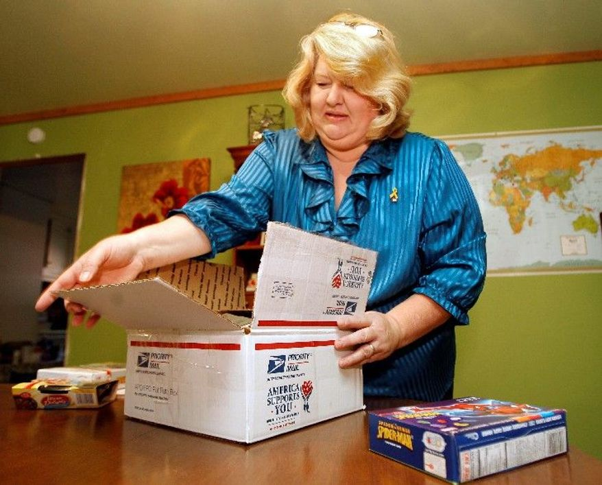 """It breaks my heart that the two things he's asking for, I can't give him one of them,"" said Susan Baldwin of Fairview, Tenn. Trying to send a recent care package, Mrs. Baldwin was told she couldn't include her son's favorite brand of cigarettes. (Associated Press)"