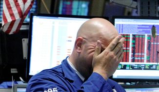 BIG DROP: A specialist reacts to the plunge on the floor of the New York Stock Exchange on Wednesday. (AP Photo)