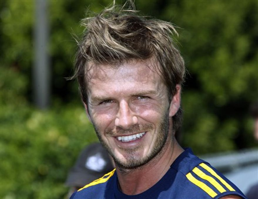 David Beckham takes part in his first practice since returning to the Los Angeles Galaxy MLS soccer team, at the Galaxy's practice facility at Home Depot Center in Carson, Calif., Wednesday, Aug. 11, 2010.  (AP Photo/Reed Saxon)