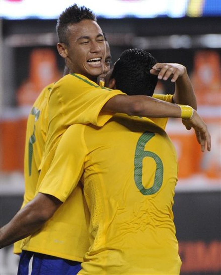 Brazil forward Neymar, center, celebrates with Paulo Henrique Ganso, left, and Alexandre Pato after Neymar scored during the first half of an international friendly soccer match against the United States Tuesday, Aug. 10, 2010 at New Meadowlands Stadium in East Rutherford, N.J. Pato also scored to give Brazil 2-0 win. (AP Photo/Bill Kostroun)
