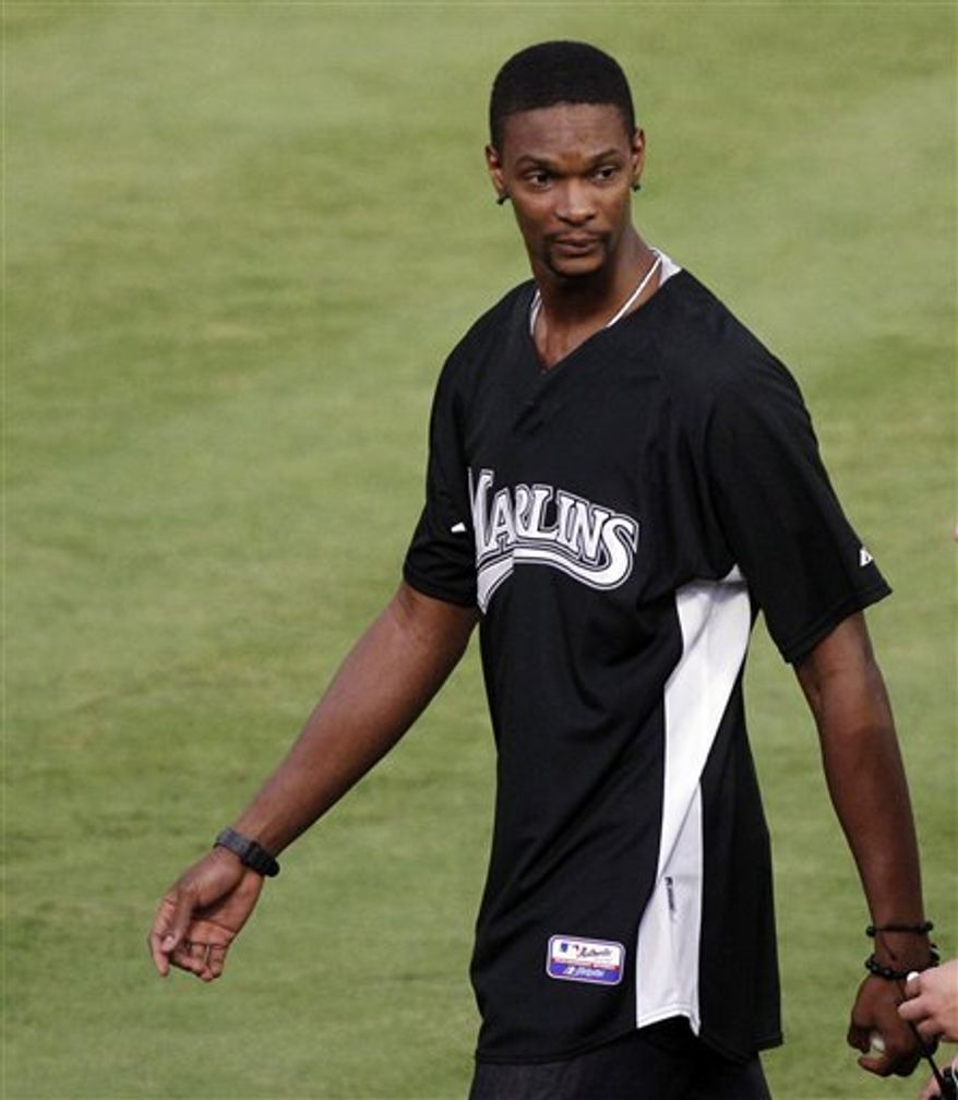 Miami Heat's Chris Bosh walks off the field before the baseball game between the Florida Marlins and the St. Louis Cardinals in Miami, Saturday, Aug. 7, 2010. (AP Photo/Alan Diaz)