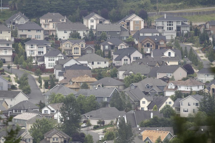 Homes cover a hillside near Happy Valley, Ore. (AP Photo/Rick Bowmer) **FILE**