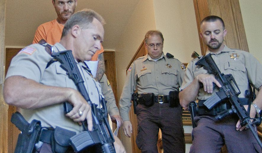Escaped convict Tracy Province leaves the Park County Courthouse in Cody, Wyo., after waiving his right to contest extradition to Arizona on Tuesday, Aug. 10, 2010. (AP Photo/Cody Enterprise, Scott Salisbury)