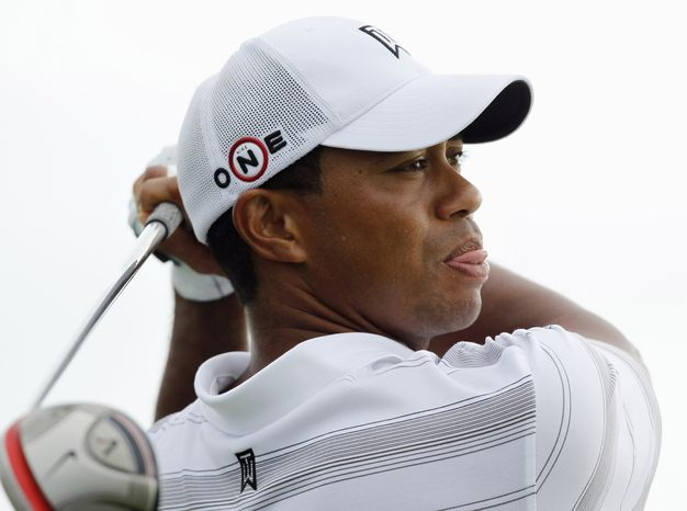 ASSOCIATED PRESS Tiger Woods  hits a drive on the 16th hole during a practice round for the PGA Championship golf tournament Wednesday, Aug. 11, 2010, at Whistling Straits in Haven, Wis.