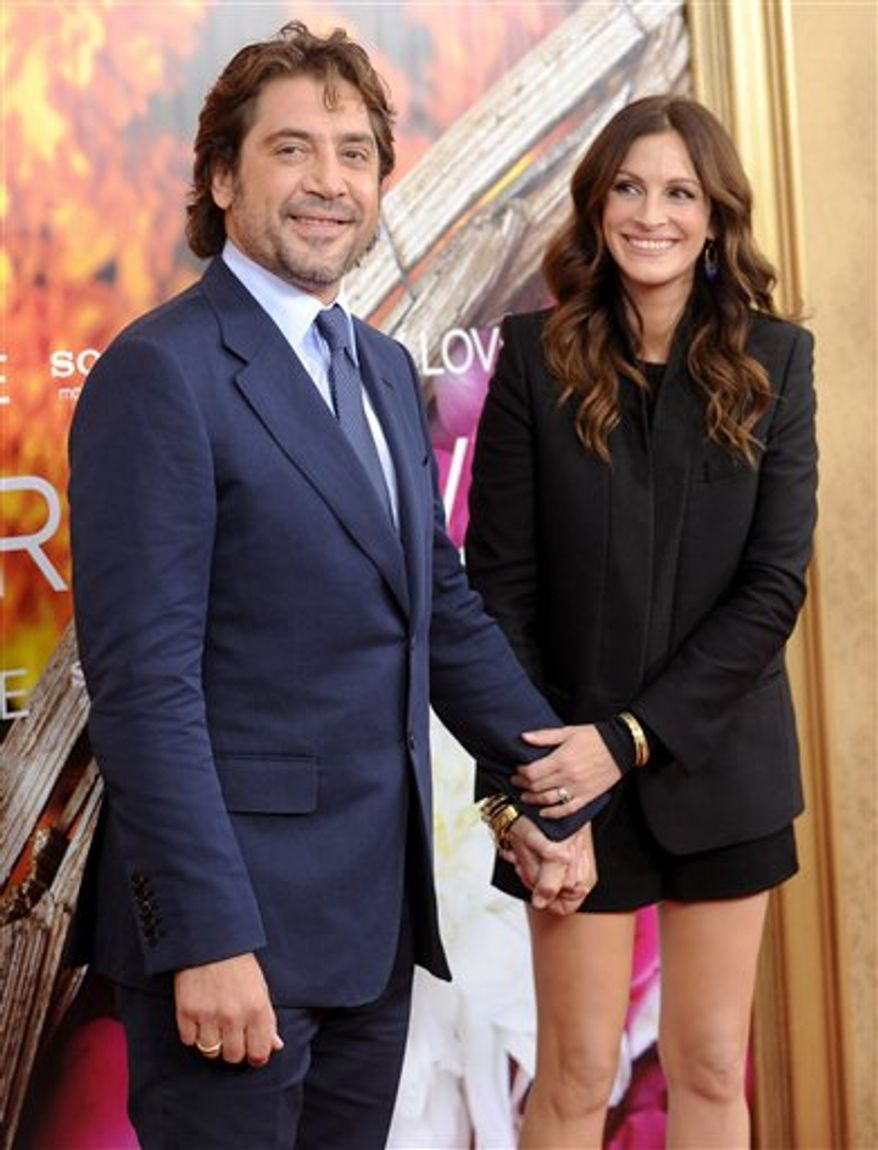 Actor Javier Bardem, left, and actress Julia Roberts attend the the world premiere of 'Eat, Pray, Love' at the Ziegfeld Theatre on Tuesday, Aug. 10, 2010 in New York. (AP Photo/Evan Agostini)