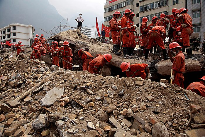 Rescue workers search for victims after a mud slide swept into the town of Zhouqu in Gannan prefecture of northwestern China's Gansu province, Wednesday, Aug. 11, 2010. The disaster in China's Gansu province was caused when a debris-blocked swollen river burst, swamping entire mountain villages. (AP Photo/Ng Han Guan)
