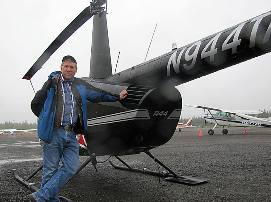 Tom Tucker, owner of Tucker Aviation is shown in Dillingham, Alaska, on Tuesday, Aug. 10, 2010, in front of his Robertson R44 helicopter. Tucker made three trips to the site of the plane crash that killed former U.S. Sen. Ted Stevens and three others Monday night northwest of Dillingham. He delivered a doctor and paramedics to the scene and helped aide survivors. (AP Photo/Mark Thiessen)