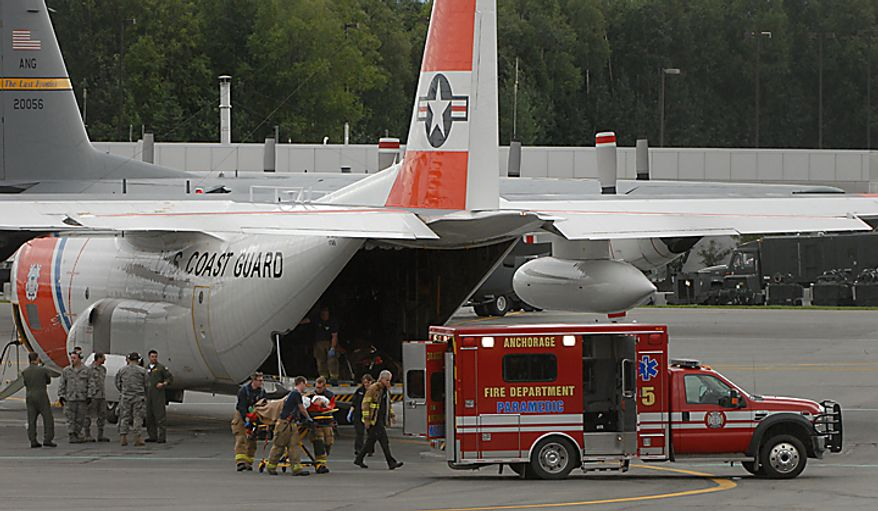 One of the survivors of the plane crash near Dillingham is transferred from a U.S. Coast Guard C-130 to a waiting Anchorage Fire Department Paramedic rig on  Tuesday, Aug. 10, 2010. Three of the plane crash survivors were transported aboard this flight to Kulis Air National Guard Base in Anchorage.    Family spokesman Mitch Rose says Stevens was among the victims of a crash outside Dillingham, Alaska about 325 miles southwest of Anchorage.  (AP Photo/The Anchorage Daily News, Bill Roth)