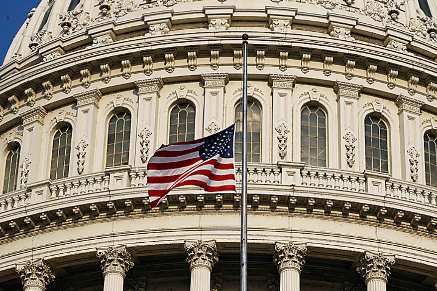 ** FILE ** An American flag flies at half-staff over the Capitol in Washington on Wednesday, Aug. 11, 2010, in honor of former Sen. Ted Stevens, who died in a plane crash in Alaska two days before. (AP Photo/Alex Brandon)