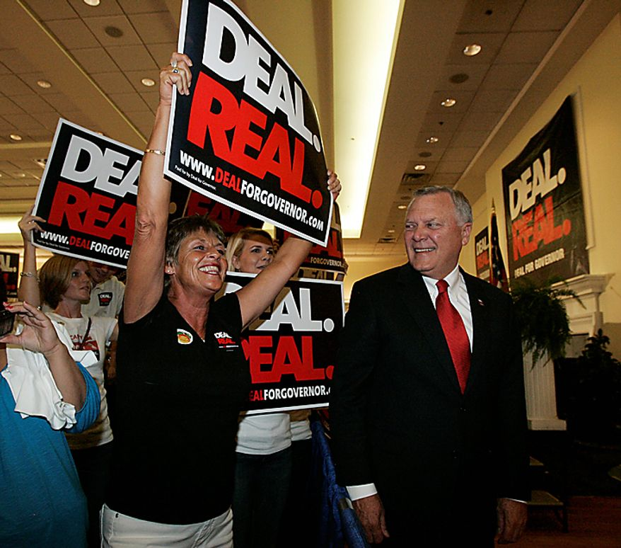 Georgia gubernatorial candidate Nathan Deal, right, looks at supporter Kay Brady of Gainesville express her enthusiasm  during a Republican primary runoff election gathering Tuesday, Aug. 10, 2010, in Gainesville, Ga. (AP Photo/John Amis)