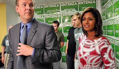 DFL gubernatorial candidate Matt Entenza and Lieutenant Governor candidate Robyne Robinson, right, leave the podium after conceding the primary campaign at their campaign headquarters in St Paul, Minn., Tuesday, Aug. 10, 2010.  (Photo/Craig Lassig)