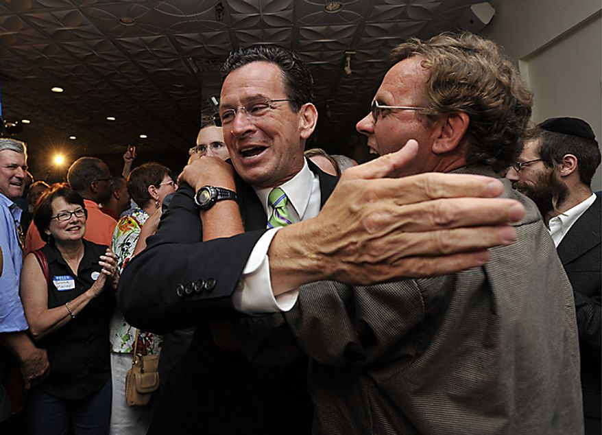 Democratic gubernatorial candidate Dan Malloy celebrates with supporters after defeating businessman Ned Lamont in the Democratic primary for Connecticut governor, in Hartford, Conn., on Tuesday, Aug. 10, 2010. (AP Photo/Jessica Hill)