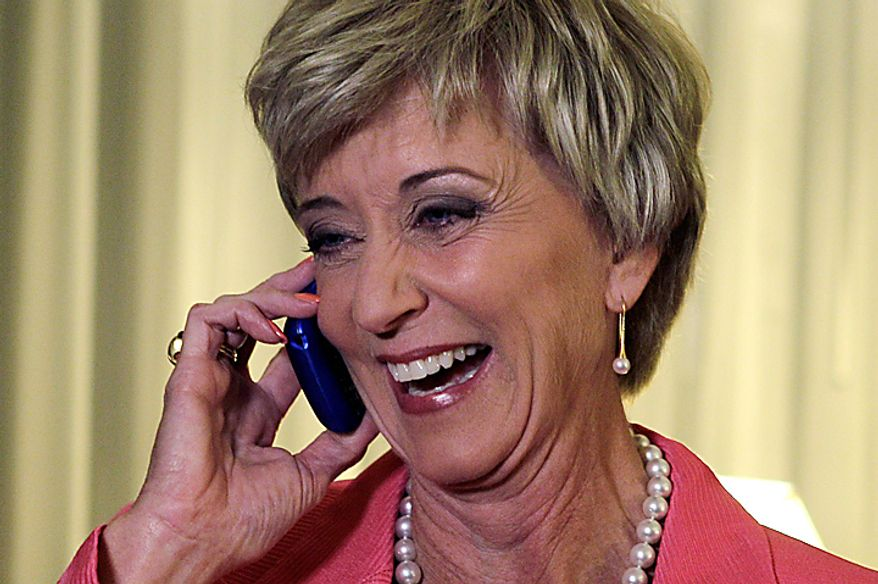 Republican candidate for U.S. Senate Linda McMahon, a former wrestling executive, takes a congratulatory call in her private suite with friends and family prior to her campaign party after winning the Republican primary in Cromwell, Conn., Tuesday, Aug. 10, 2010. (AP Photo/Charles Krupa)