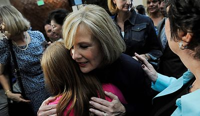 GOP Senatorial candidate, Jane Norton hugs supporters after giving her concession speech on Tuesday Aug. 10, 2010 at the Marriott in Highlands Ranch, Colo. Buck, the Weld District Attorney, defeated former Colorado Lieutenant Governor Jane Norton for the nomination.  (AP Photo/MATT MCCLAIN, The Denver Post)