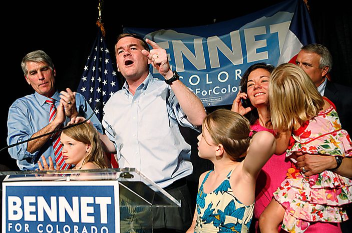Sen. Michael Bennet, center, D-Colo., celebrates after winning the Democratic primary on Tuesday, Aug. 10, 2010, in Denver. He was joined on stage by his wife, third right, children, Senator Mark Udall, left, and Gov. Bill Ritter, back right. (AP Photo/Ed Andrieski)