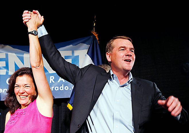 Senator Michael Bennet, D-Colo., celebrates with his wife Susan Dagget after winning the Democratic primary at an election party on Tuesday, Aug. 10, 2010 in Denver. (AP Photo/Ed Andrieski)