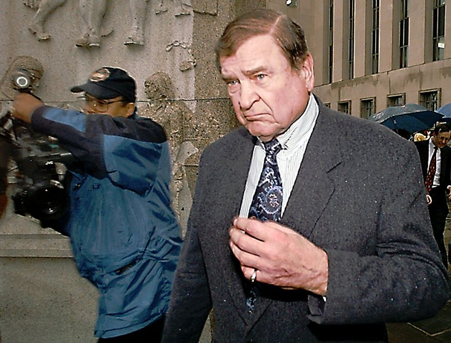 """Former Rep. Dan Rostenkowski of Illinois departs the federal courthouse Tuesday, April 9, 1996 in Washington after pleading guilty on two counts of mail fraud. He was sternly told by a judge that he brought """"a measure of disgrace"""" to Congress. Rostenkowski was immediately sentenced to 17 months in prison and ordered to pay a $100,000 fine. (AP Photo/Greg Gibson)"""