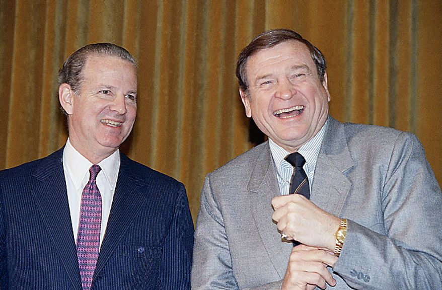 Treasury Secretary James Baker III, left, shares a light moment with House Ways and Means Committee Chairman Dan Rostenkowski of Illinois on Capitol Hill in Washington, Tuesday, Feb. 10, 1987. Baker told the committee that the U.S. trade deficit appears to be leveling off under pressure from a declining dollar and indicated that further falls in the dollar against the Japanese yen may not be desirable. (AP Photo/John Duricka)