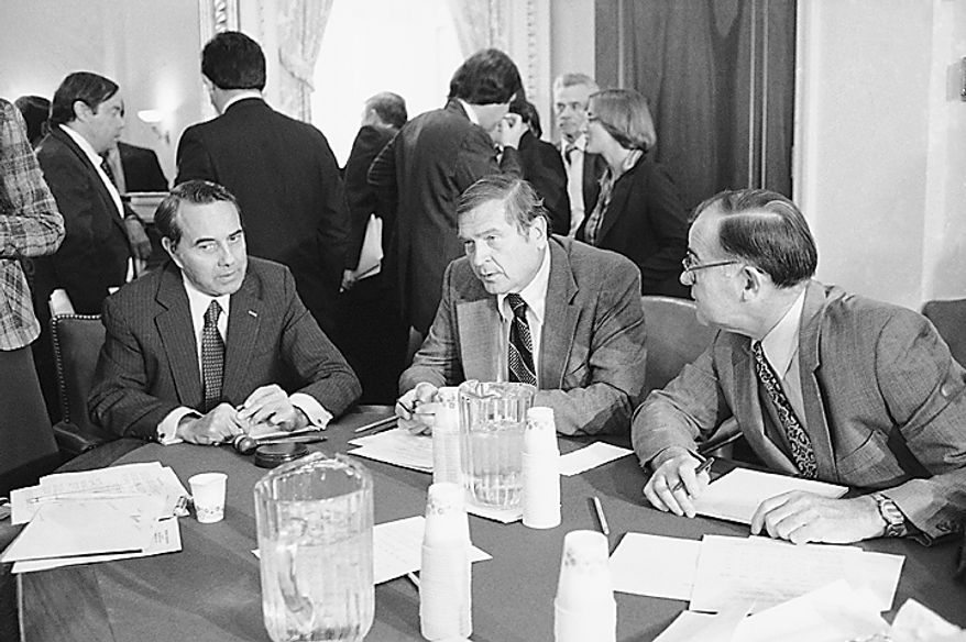 Members of a joint Senate-House conference on social security get together, Monday, Nov. 16, 1981 in Capitol Hill to discuss the problems of the program. From left are: Senate Budget Director Robert Dole, R-Kan.; house ways and means chairman Dan Rostenkowski, D-Ill. and Rep. Barber Conable, R-N.Y. (AP Photo/John Duricka)