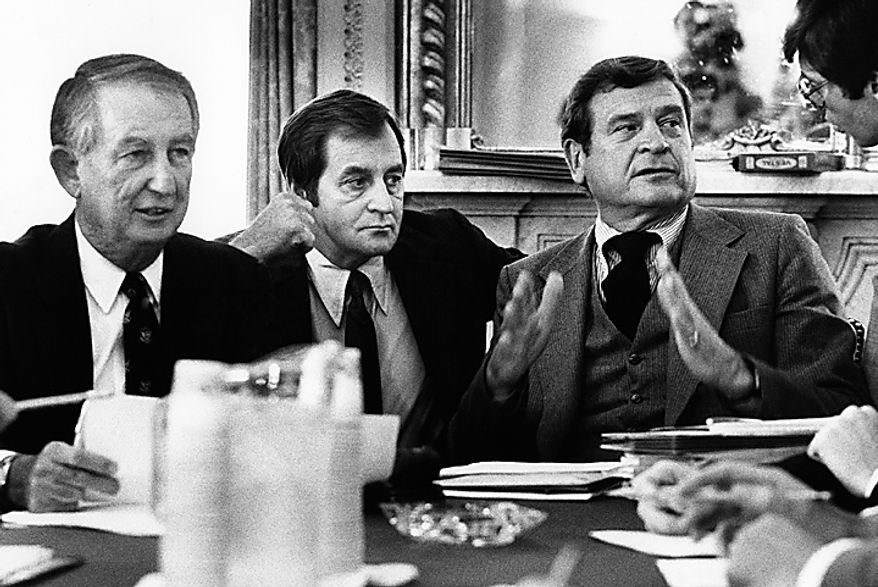 Democratic members of the House Ways and Means Committee meet at Capitol Hill in Washington where it was indicated that they would support a two-year tax cut plan in opposition to the three-year one offered by the Reagan administration, June 3, 1981.  From left are panel members Sam Gibbons of Fla. and chairman of the panel Dan Rostenkowski of Ill. Men in center and right are unidentified aides. (AP Photo/John Duricka)