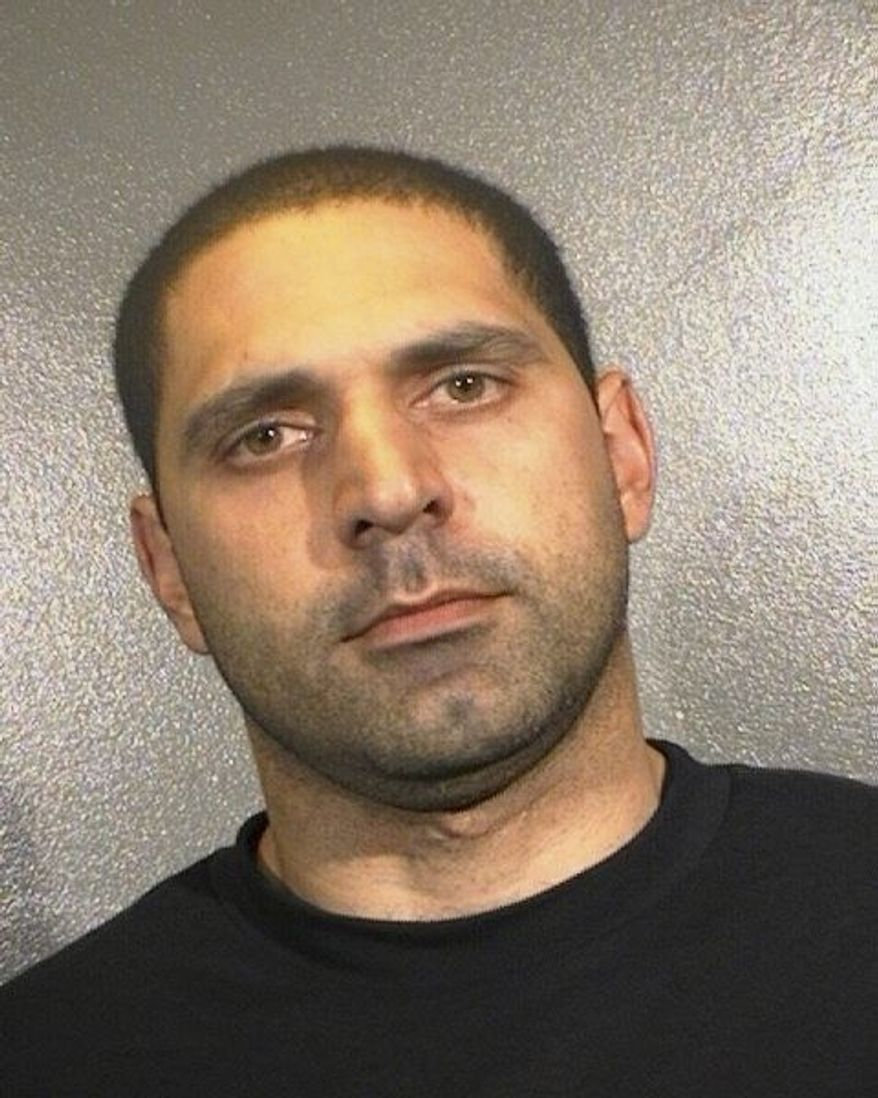 ASSOCIATED PRESS Elias Abuelazam was charged Thursday with assault with intent to murder in connection with a July 27 stabbing in Flint, Mich.
