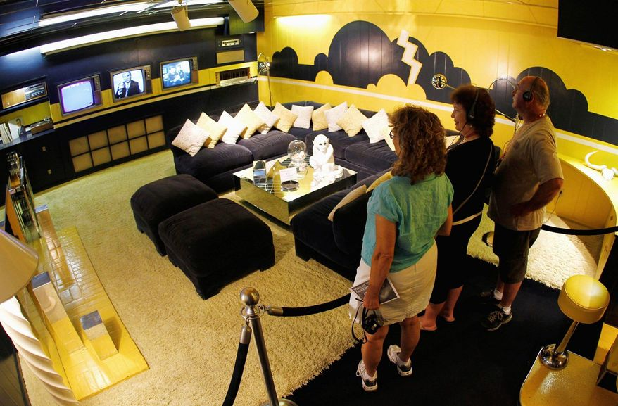 Associated Press photographs Tourists view the TV room at Graceland, Elvis Presley's home in Memphis, Tenn. CKx Inc., owner of 85 percent of Elvis Presley Enterprises, is considering at least two offers to buy the company.