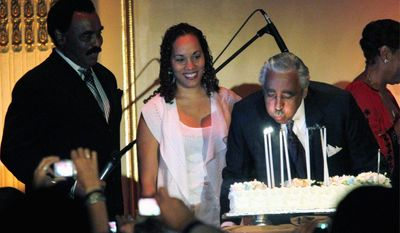 ASSOCIATED PRESS Joined by his daughter Alicia, and singer Chuck Jackson, Rep. Charles B. Rangel blows out candles on a cake during his birthday fundraiser on Wednesday. Mr. Rangel said he was eager to turn his attention to campaigning and let his ethics charges play out.