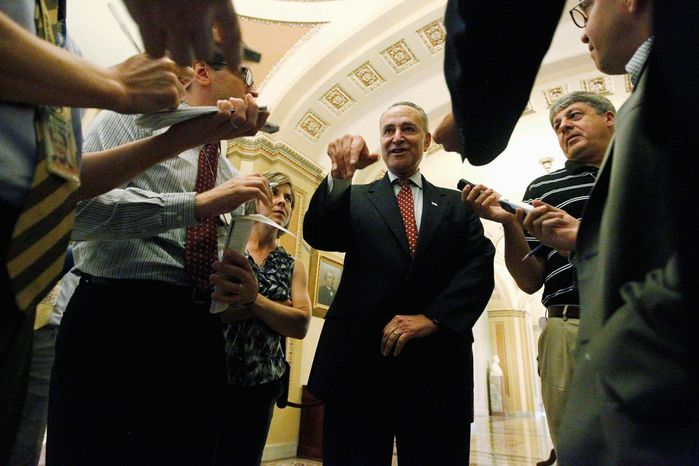 ASSOCIATED PRESS Sen. Charles E. Schumer, New York Democrat, speaks to reporters off the Senate floor Thursday. He said he hopes a $600 million border-security measure approved Thursday clears the way for consideration of comprehensive immigration-reform legislation.