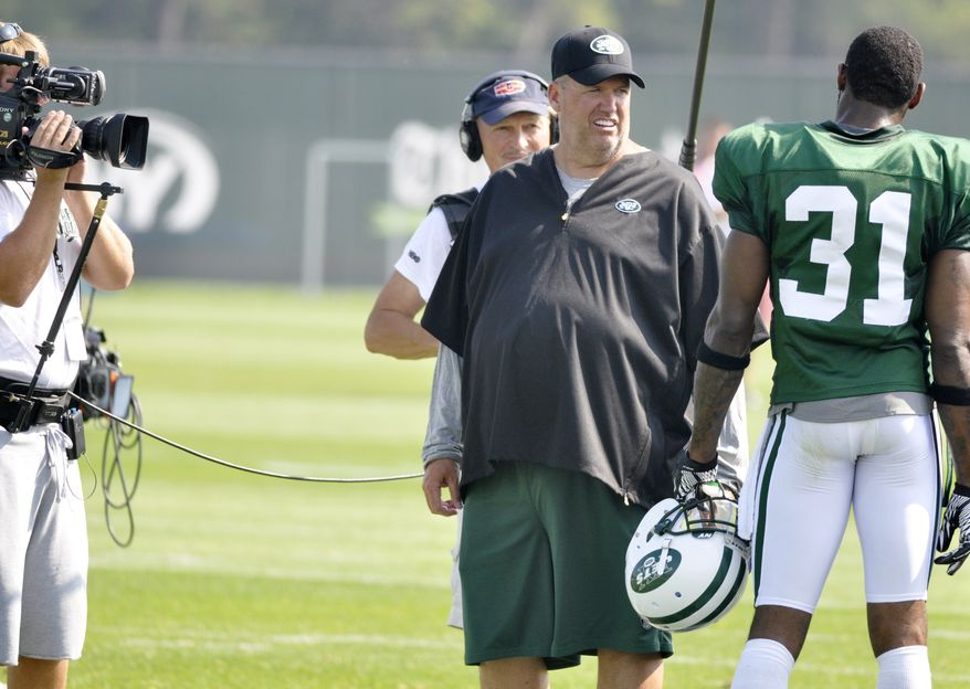 ASSOCIATED PRESS New York Jets head coach Rex Ryan  talks with defensive back Antonio Cromartie, right, as a Hard Knocks film crew record the conversation during morning practice at the team's NFL football training camp in Cortland, N.Y., Wednesday, Aug. 4, 2010.