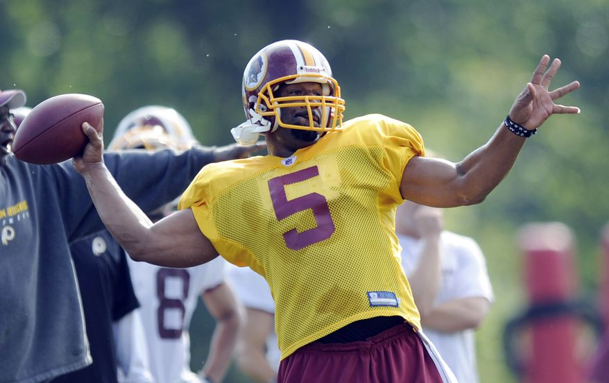 ASSOCIATED PRESS Washington Redskins quarterback Donovan McNabb looks to pass during practice at the NFL football team's training camp, Saturday, July 31, 2010, at Redskins Park in Ashburn, Va.