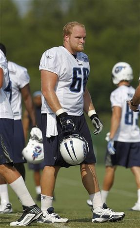 FILE - This Aug. 11, 2010, file photo shows Tennessee Titans center Kevin Matthews (60) during NFL football training camp , in Nashville, Tenn.   (AP Photo/Mark Humphrey, File)