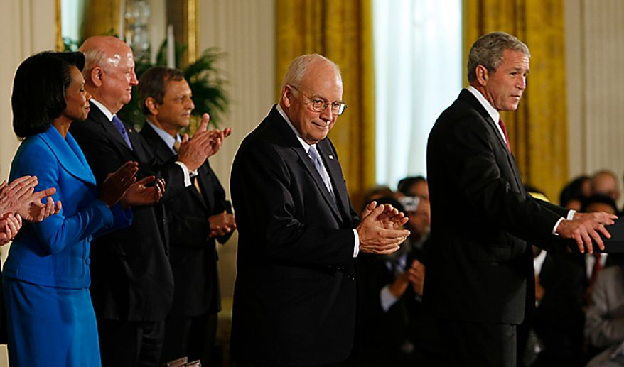 Vice President Dick Cheney, center, applauds as President Bush, right, speaks before signing the United States-India Nuclear Cooperation Approval and Nonproliferation Enhancement Act during ceremony in the East Room of the White House in Washington, Wednesday, Oct. 8, 2008. Standing behind them on stage are, from left to right, Secretary of State Condoleezza Rice, Energy Secretary Samuel Bodman, and Indian Ambassador to the U.S. Ronen Sen. (AP Photo/Pablo Martinez Monsivais)