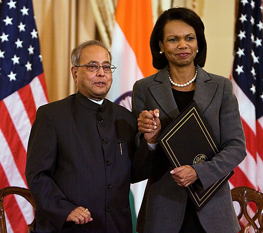 Secretary of State Condoleezza Rice and Indian Foreign Minister Pranab Mukherjee clasp hands after signing the U.S.-India Agreement for Cooperation Concerning Peaceful Uses of Nuclear Energy during a ceremony at the State Department, Friday, Oct. 10, 2008, in Washington.  (AP Photo/Manuel Balce Ceneta)