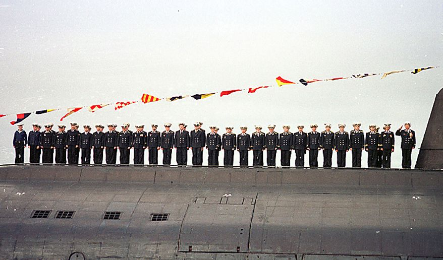 Crew members of the nuclear submarine Kursk, one of Russia's largest and most advanced submarines, stand on the ship deck during the naval parade in Severomorsk in this July 30, 2000  photo. Kursk Captain Gennady Lyachin stands at right. The Kursk submarine tragedy that killed 118 crew members was caused by fuel exploding in one of its torpedoes, the governmental commission investigating the accident has found, according to a news report Monday, July 1, 2002.(AP Photo/ Str)