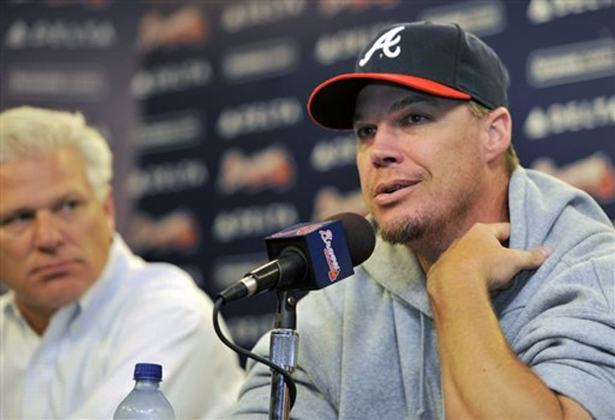 Atlanta Braves third baseman Chipper Jones, right, speaks as Braves executive vice president and general manager Frank Wren, left, looks on during a news conference where Jones discussed his injury and future with media, Friday, Aug. 13, 2010, at Turner Field in Atlanta. (AP Photo/Gregory Smith)