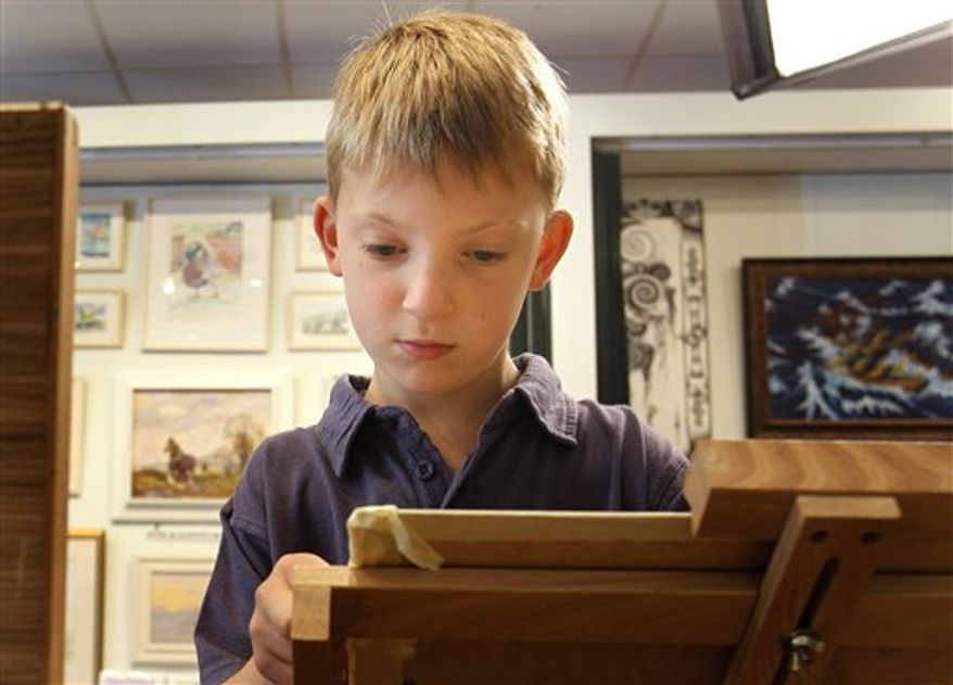 In this Thursday, Aug. 12, 2010 a painting called 'Sailing on the Broads' by Kieron Williamson, an eight-year-old painting prodigy is seen displayed in an art gallery in Holt, Norfolk in England. He's Britain's most talked-about young artist. His paintings sell for thousands of dollars and there's a long waiting list for his eagerly anticipated new works. (AP Photo/Kirsty Wigglesworth)