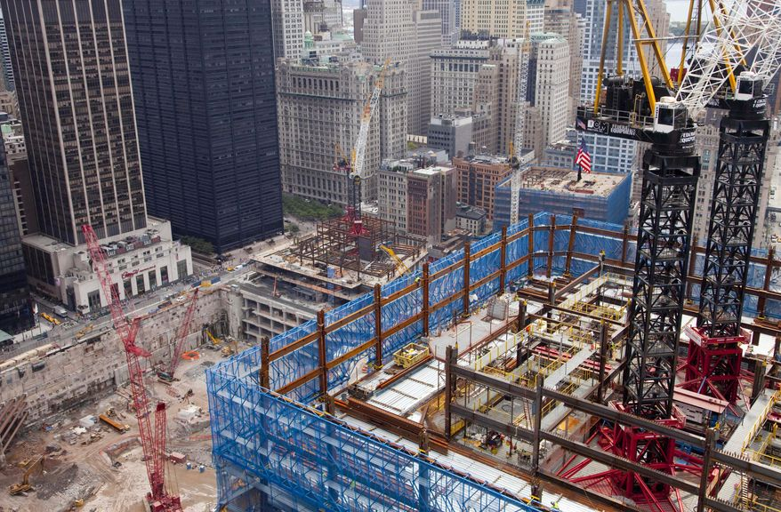 Construction cranes tower above One World Trade Center, Friday, August 13, 2010 in New York. A mosque would be part of a proposed $100 million Islamic center two blocks from where nearly 3,000 people perished when hijacked jetliners slammed into the World Trade Center towers on Sept. 11, 2001.(AP Photo/Mark Lennihan)