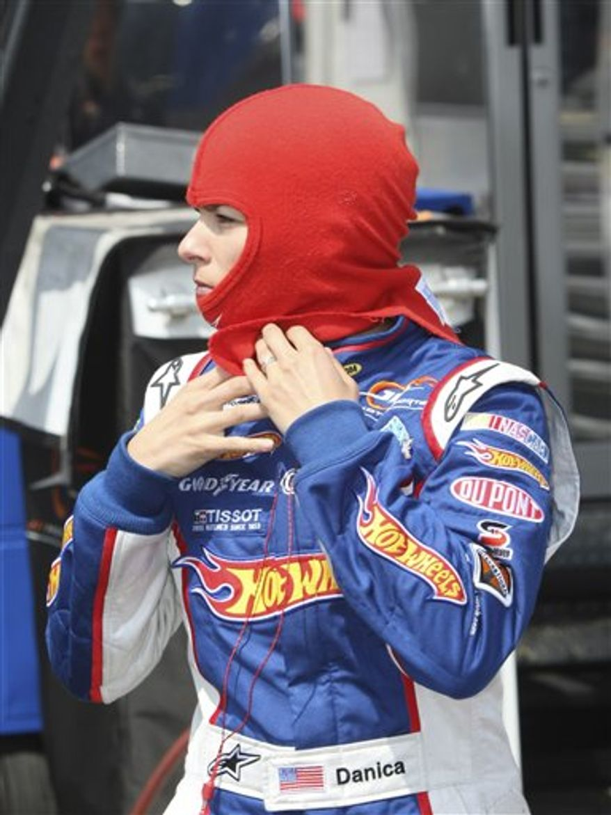 Danica Patrick drives out of the paddock area for her NASCAR Nationwide Series practice laps at Michigan International Speedway in Brooklyn, Mich., Friday, Aug. 13, 2010. (AP Photo/Bob Brodbeck)