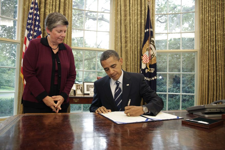 Homeland Security Secretary Janet Napolitano watches as President Barack Obama signs the Southwest Border Security Bill on Friday, Aug. 13, 2010, in the Oval Office of the White House in Washington. (AP Photo/Carolyn Kaster)