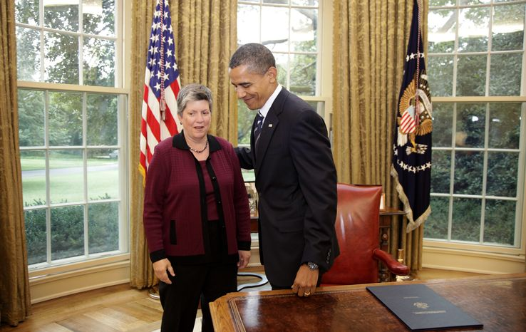 Homeland Security Secretary Janet Napolitano and President Barack Obama prepare to leave the Oval Office of the White House in Washington, Friday, Aug. 13, 2010, after Obama signed the Southwest Border Security Bill. (AP Photo/Carolyn Kaster)