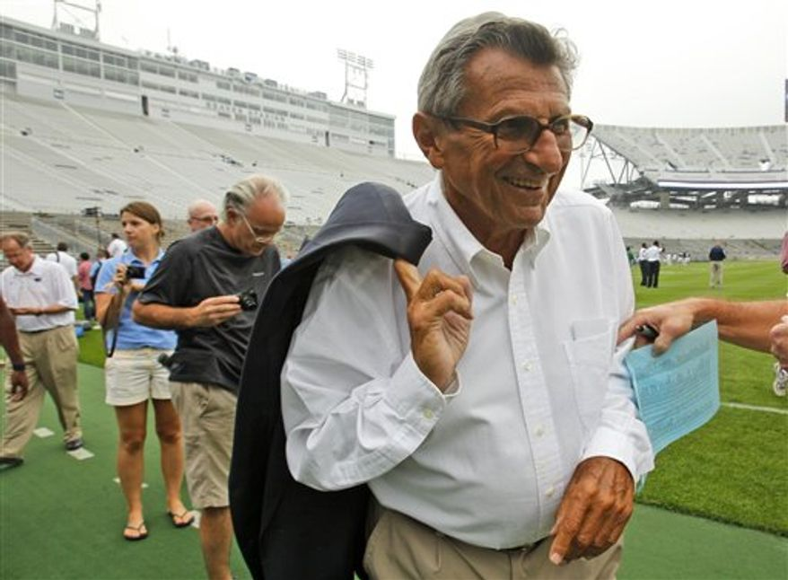 Penn State coach Joe Paterno walks off the field at Beaver Stadium after the football team's media day in State College, Pa., Thursday, Aug. 12, 2010. Paterno is heading into his 45th season as head coach of Penn State. (AP Photo/Gene J. Puskar)