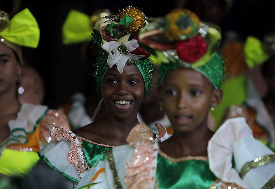 """Children in costume perform at an event celebrating the 84th birthday of Fidel Castro at the Ernesto """"Che"""" Guevara Palace of Pioneers in Havana, Cuba, Friday Aug. 13, 2010. (AP Photo/Javier Galeano)"""