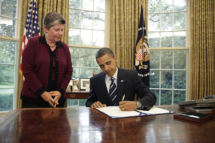 Homeland Security Secretary Janet Napolitano watches as President Barack Obama signs the Southwest Border Security Bill, Friday, Aug. 13, 2010, in the Oval Office of the White House in Washington. (AP Photo/Carolyn Kaster)
