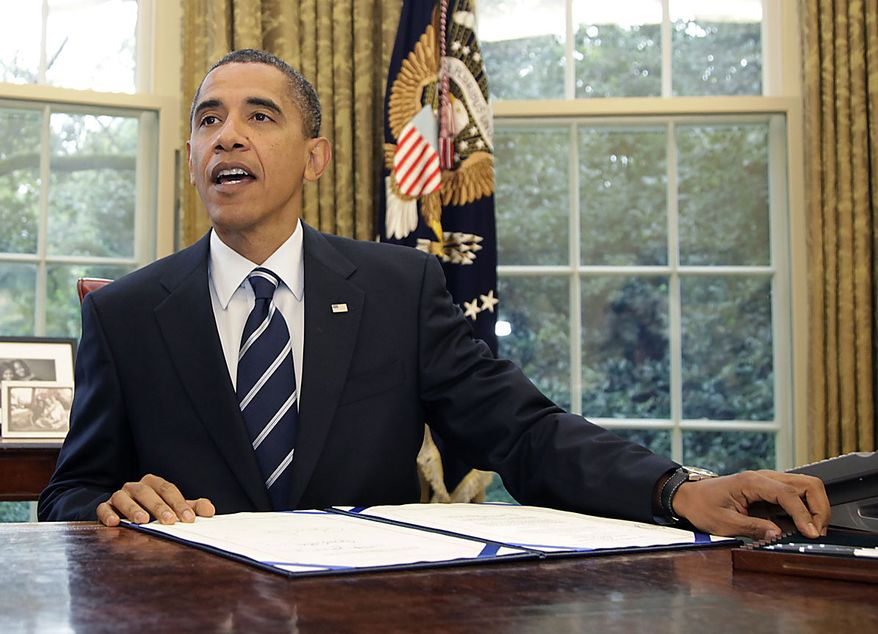 President Barack Obama looks up in the Oval Office of the White House in Washington, Friday, Aug. 13, 2010, after signing the Southwest Border Security Bill. (AP Photo/Carolyn Kaster)