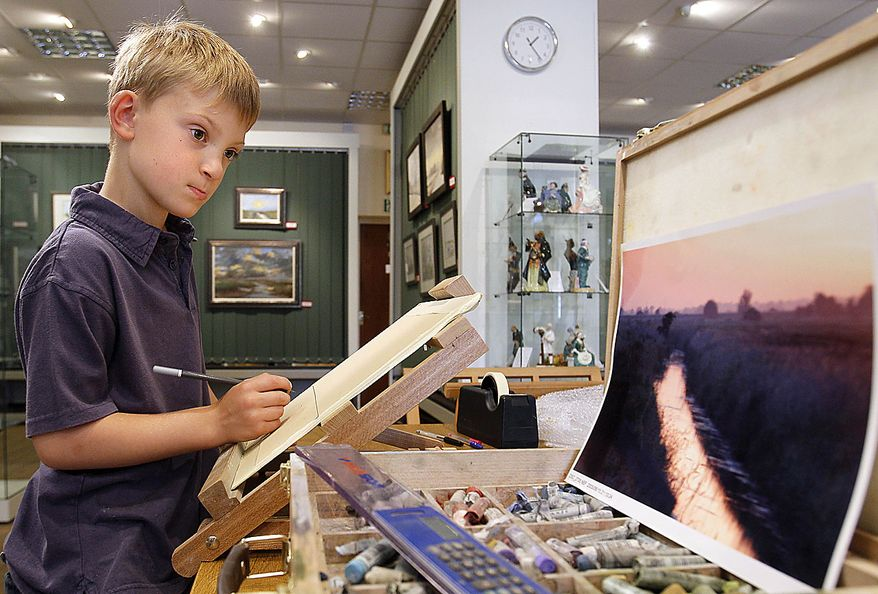 In this Thursday, Aug. 12, 2010 photo Kieron Williamson, an eight-year-old painting prodigy is seen working on a drawing in Holt, Norfolk in England. He's Britain's most talked-about young artist. His paintings sell for thousands of dollars and there's a long waiting list for his eagerly anticipated new works. (AP Photo/Kirsty Wigglesworth)