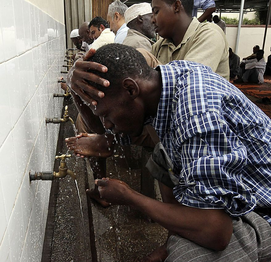 A Muslim man perform ablution before the prayers at a mosque during the first Friday in the holy month of Ramadan in Nairobi, Kenya, Friday, Aug.13, 2010.(AP Photo/Sayyid Azim)