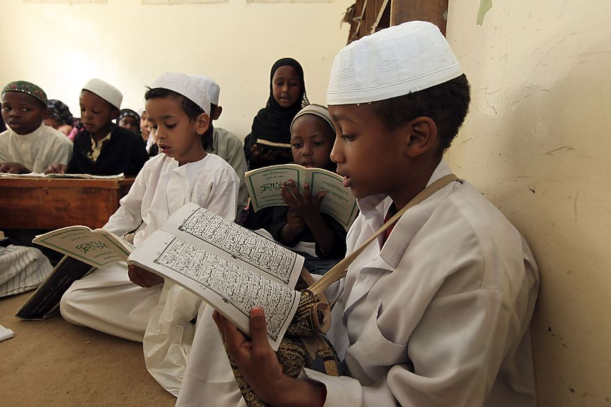 Children in a Madrassa reciting the Holy Quran during the start of the holy month of Ramadan in Nairobi, Kenya, Thursday, Aug.12, 2010. Muslims all over the world observe this month by fasting, reciting the Quran and eating according to laid down custom.(AP Photo/Sayyid Azim)