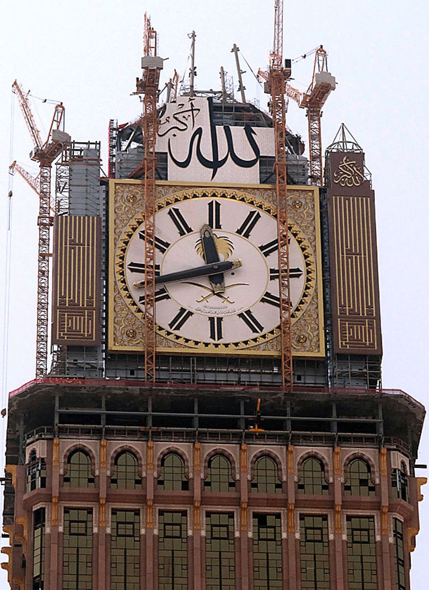 A four-faced clock, atop the Abraj Al-Bait Towers is seen under construction in Mecca, Saudi Arabia Thursday Aug. 12, 2010. Saudi Arabia will test what it is billing as the world's largest clock in the holy city of Mecca during the Muslim fasting month of Ramadan.The four-faced clock tower will top a massive skyscraper that when completed will be around 1,970 feet (600 meters) tall, the second tallest in the world after Dubai's Burj Khalifa. The complex overlooks Mecca's famed Grand Mosque, which Muslims worldwide face during their five daily prayers and is part of Saudi efforts to develop the city visited by millions of pilgrims every year.    (AP Photo/Essa Mohammad)
