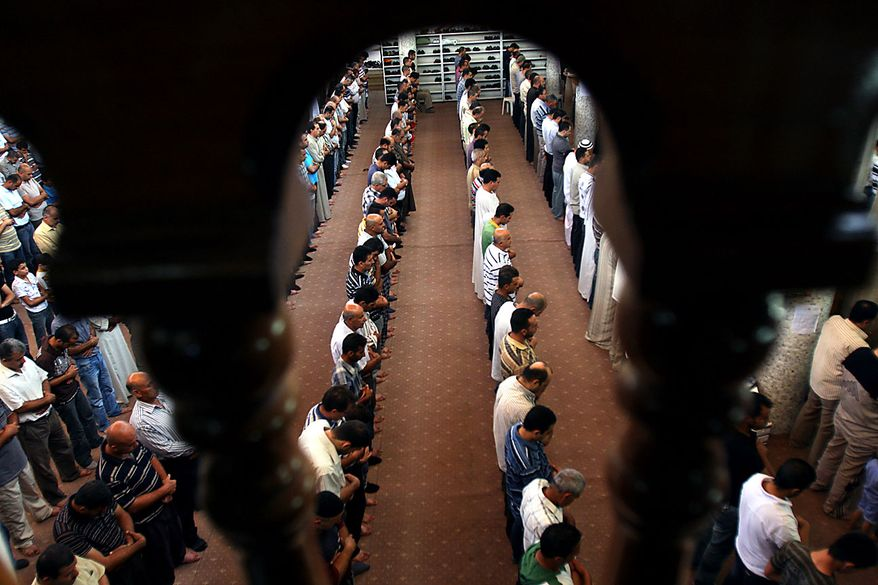 Palestinians pray on the first Friday of the Muslim holy month of Ramadan at a mosque in the West Bank city of Jenin, Friday, Aug. 13, 2010.(AP Photo/Mohammed Ballas)